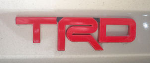 """TRD"" badge or emblem - Red"